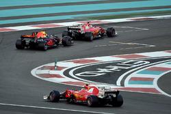 Kimi Raikkonen, Ferrari SF70H and Max Verstappen, Red Bull Racing RB13 battle with Sebastian Vettel, Ferrari SF70H