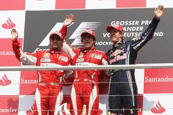 The podium: second placed Felipe Massa, Ferrari with race winner Fernando Alonso, Ferrari and third placed Sebastian Vettel, Red Bull Racing