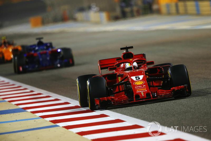 Sebastian Vettel, Ferrari SF71H, leads Brendon Hartley, Toro Rosso STR13 Honda