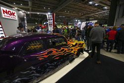 A custom car on the NGK stand