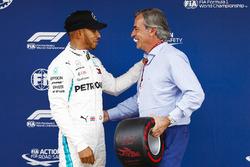Lewis Hamilton, Mercedes AMG F1, celebrates pole position with Carlos Sainz
