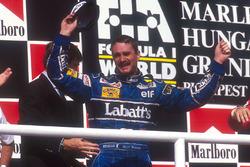 Podium: second place Nigel Mansell, Williams Renault celebrates winning the drivers World Championship