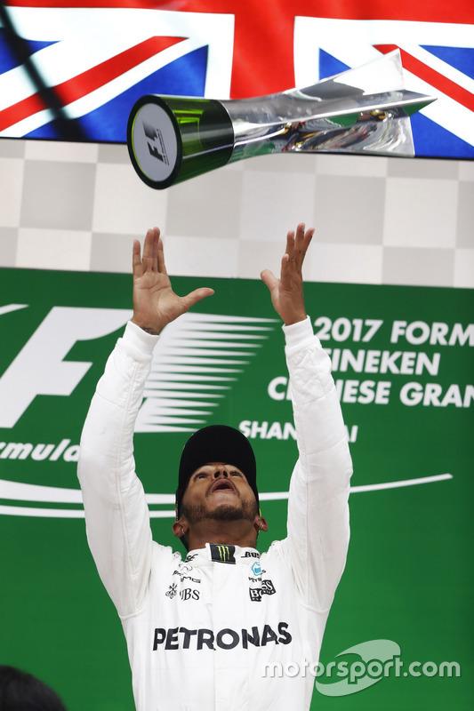Lewis Hamilton, Mercedes AMG, celebrates taking victory on the podium