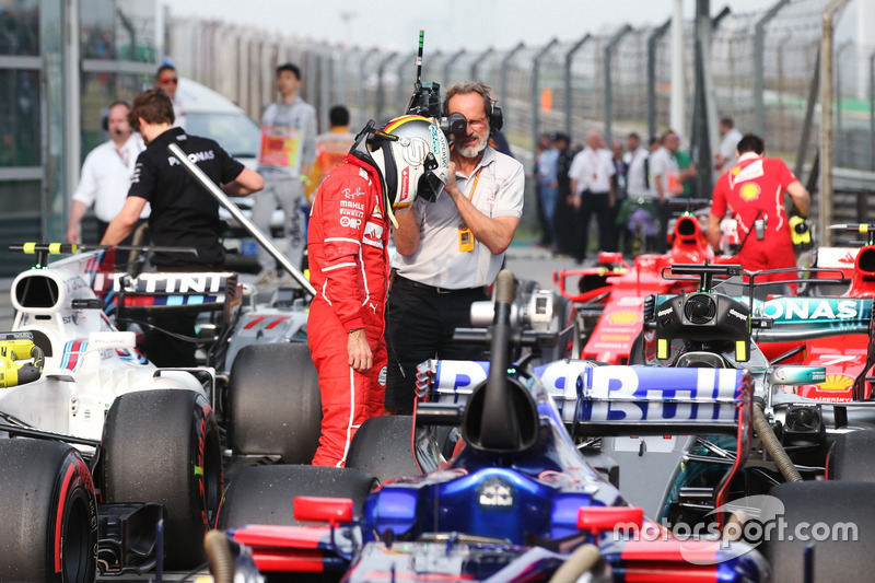 Sebastian Vettel, Ferrari, inspects the car of Lewis Hamilton, Mercedes AMG F1 W08, in Parc Ferme after Qualifying