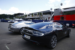 A pair of Red Bull branded Aston Martins in the paddock