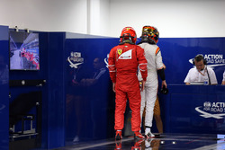 Kimi Raikkonen, Ferrari and Stoffel Vandoorne, McLaren in parc ferme weigh-in area