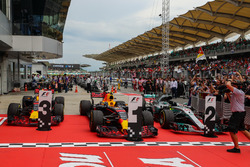The cars of race winner Max Verstappen, Red Bull Racing RB13, Daniel Ricciardo, Red Bull Racing RB13 and Lewis Hamilton, Mercedes-Benz F1 W08  in parc ferme