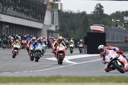 Riders leave the pits after tyre change