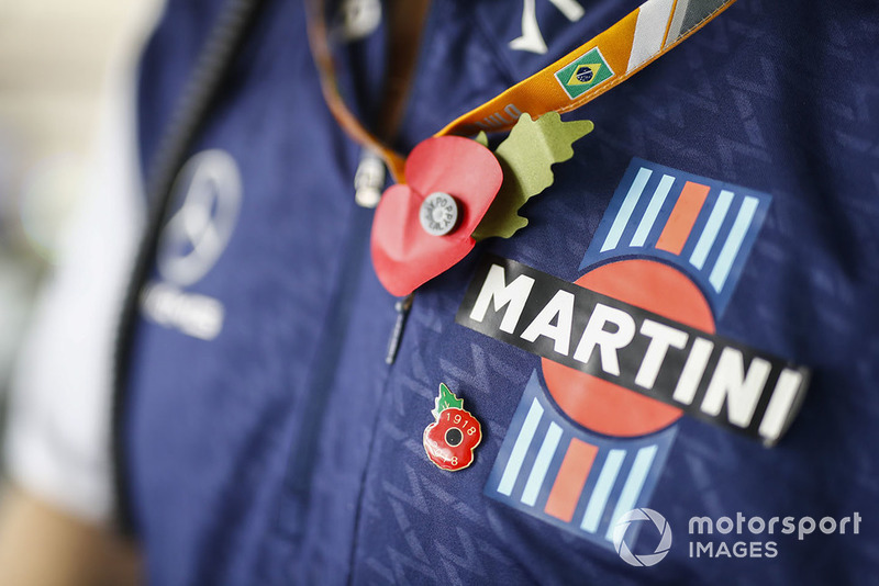 A poppy is worn on the shirt of a Williams team member