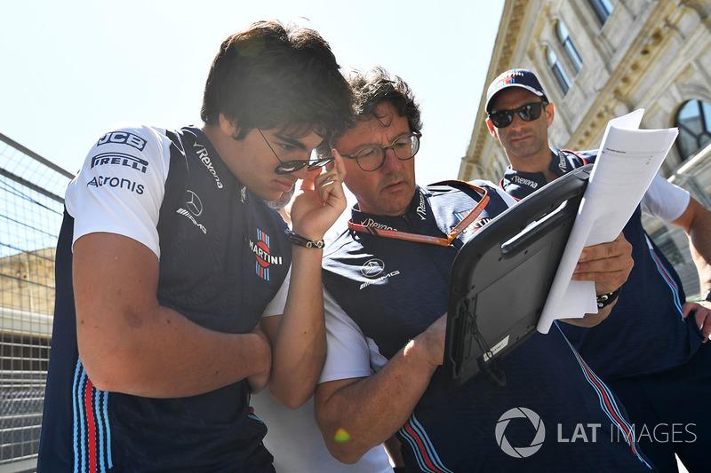 Lance Stroll, Williams Lance Stroll, Williams and Luca Baldisserri, Williams Race Engineer walk the track