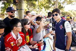 Lance Stroll, Williams Racing, takes a selfie with a fan