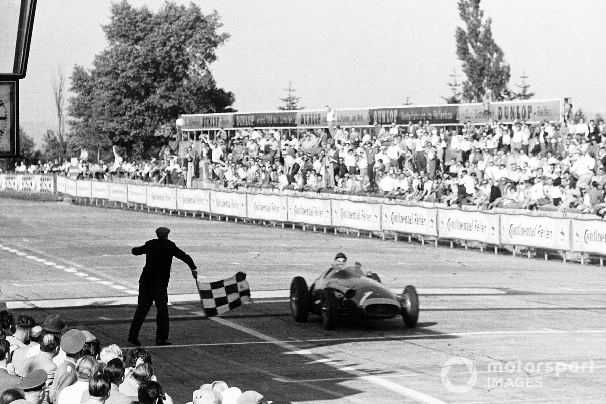 Juan Manuel Fangio, Maserati 250F takes the chequered flag