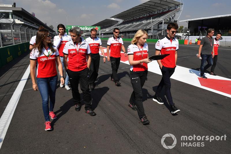Tatiana Calderon, Sauber Test Driver and Charles Leclerc, Sauber walk the track