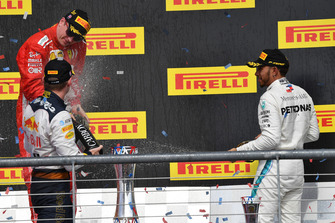 (L to R): Kimi Raikkonen, Ferrari, Max Verstappen, Red Bull Racing and Lewis Hamilton, Mercedes AMG F1 celebrate with the champagne on the podium with the trophy