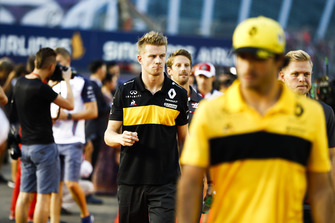 Nico Hulkenberg, Renault Sport F1 Team, walks behind Carlos Sainz Jr., Renault Sport F1 Team, but ahead of Romain Grosjean, Haas F1 Team, and Kevin Magnussen, Haas F1 Team