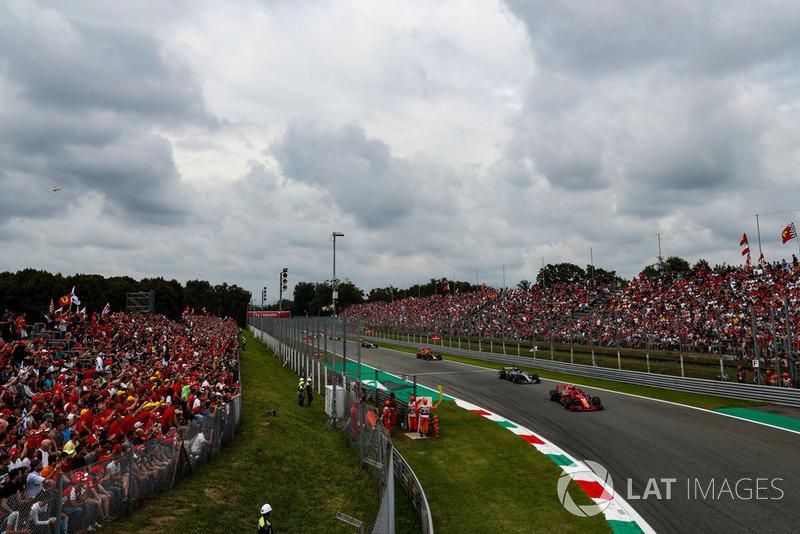 Kimi Raikkonen, Ferrari SF71H, leads Lewis Hamilton, Mercedes AMG F1 W09, and Max Verstappen, Red Bull Racing RB14