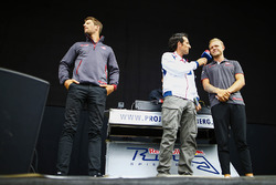 Kevin Magnussen, Haas F1 Team, and Romain Grosjean, Haas F1 Team, are presented on stage during a fan event