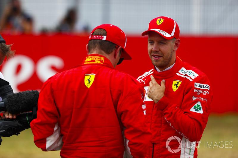 Kimi Raikkonen, Ferrari, and pole sitter Sebastian Vettel, Ferrari