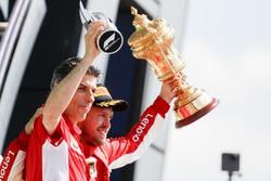 Sebastian Vettel, Ferrari, on the podium with the Ferrari Constructors trophy delegate