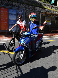 Charles Leclerc, Sauber on a bike and Brendon Hartley, Scuderia Toro Rosso on a scooter