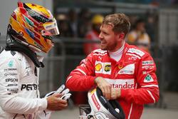 Sebastian Vettel, Ferrari con Lewis Hamilton, Mercedes AMG