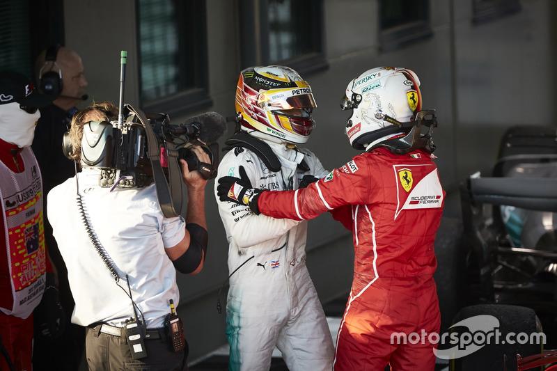 Sebastian Vettel, Ferrari, 1st Position, and Lewis Hamilton, Mercedes AMG, 2nd Position, congratulate each other in Parc Ferme