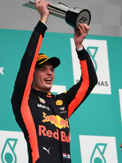 Race winner Max Verstappen, Red Bull Racing celebrates on the podium, the trophy