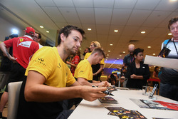 Jolyon Palmer, Renault Sport F1 Team and Nico Hulkenberg, Renault Sport F1 Team sign autographs for the fans