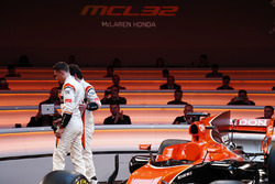 Race drivers Stoffel Vandoorne and Fernando Alonso leave the stage at the launch of the McLaren MCL32
