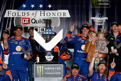 Brad Keselowski, Team Penske Ford, and his team poses with the trophy in Victory Lane after winning
