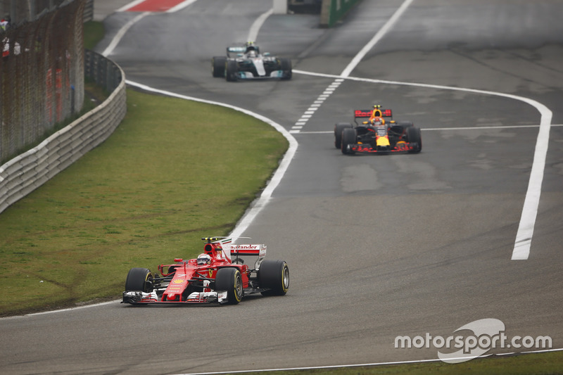 Kimi Raikkonen, Ferrari SF70H, leads Max Verstappen, Red Bull Racing RB13 and Valtteri Bottas, Mercedes AMG F1 W08