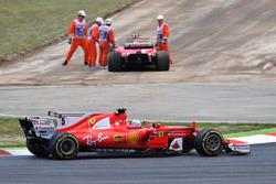 Sebastian Vettel, Ferrari SF70H passes race retiree Kimi Raikkonen, Ferrari SF70H