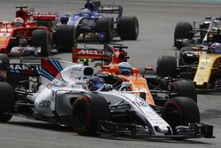 Lance Stroll, Williams FW40, battles Fernando Alonso, McLaren MCL32, Sebastian Vettel, Ferrari SF70H