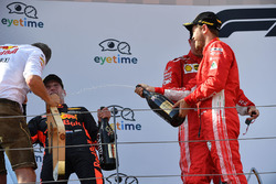 Max Verstappen, Red Bull Racing, Sebastian Vettel, Ferrari and Kimi Raikkonen, Ferrari celebrate on the podium with the champagne