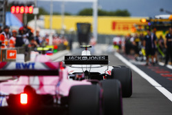 Kevin Magnussen, Haas F1 Team VF-18, and Esteban Ocon, Force India VJM11, in the pit lane