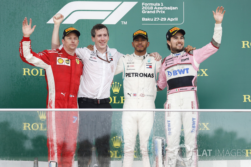 Kimi Raikkonen, Ferrari, 2nd position, the Mercedes Constructors trophy delegate, Lewis Hamilton, Mercedes AMG F1, 1st position, and Sergio Perez, Force India, 3rd position, on the podium