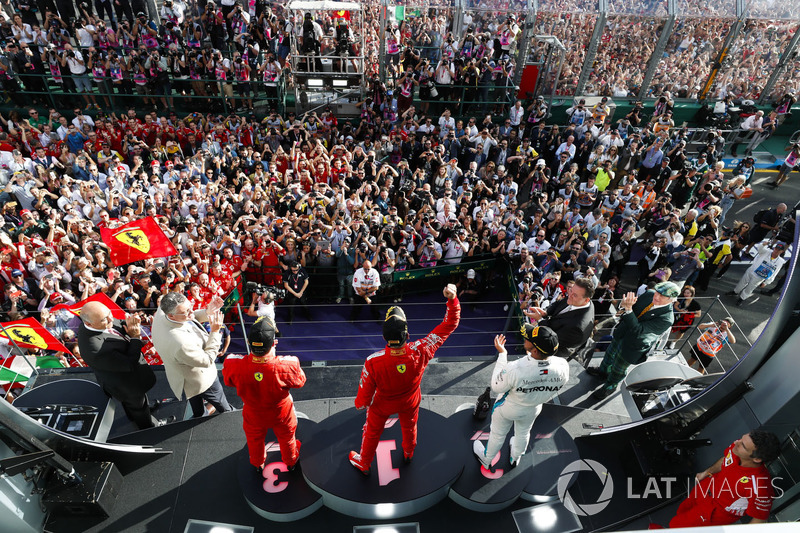 Race winner Sebastian Vettel, Ferrari, second place Lewis Hamilton, Mercedes AMG F1, third place, Kimi Raikkonen, Ferrari, celebrate on the podium