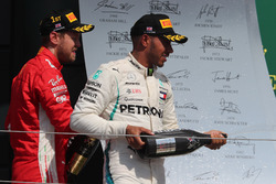 Sebastian Vettel, Ferrari and Lewis Hamilton, Mercedes AMG F1 on the podium