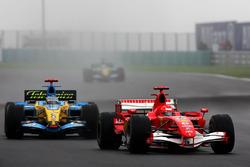 Michael Schumacher, Ferrari 248 F1 leads Fernando Alonso, Renault R26
