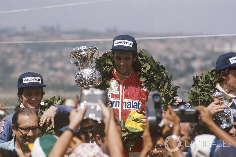 Podium: race winner Niki Lauda, Ferrari, Patrick Depailler, Tyrrell 007, third place Tom Pryce, Shad