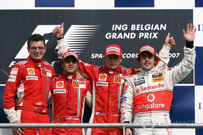 Podium: Chris Dyer, Ferrari race engineer, second placed Felipe Massa, Ferrari, race winner Kimi Raikkonen, Ferrari, and third placed Fernando Alonso, McLaren