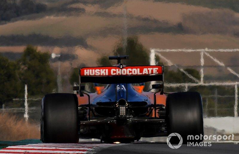 Carlos Sainz Jr., McLaren MCL34, strikes sparks on a kerb