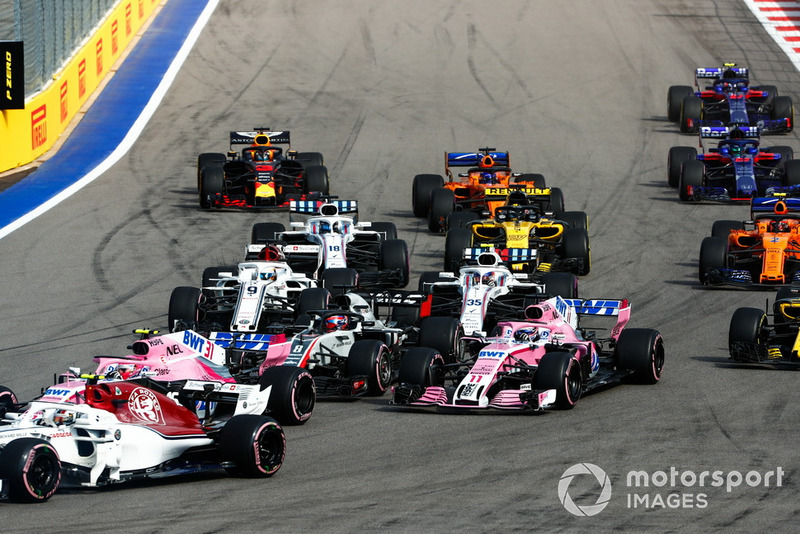 Charles Leclerc, Sauber C37, leads Esteban Ocon, Racing Point Force India VJM11, Romain Grosjean, Haas F1 Team VF-18, Sergio Perez, Racing Point Force India VJM11, Marcus Ericsson, Sauber C37, and the remainder of the field at the start of the race