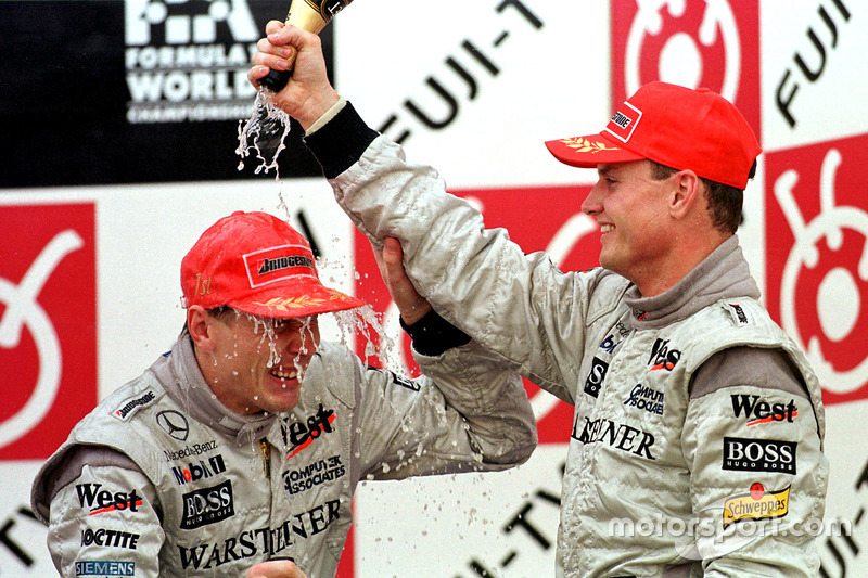 Podium:  David Coulthard and Mika Hakkinen celebrate