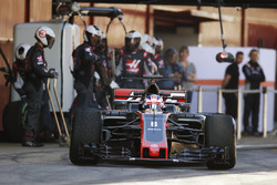 Kevin Magnussen, Haas F1 Team VF-17, exits a pit stop