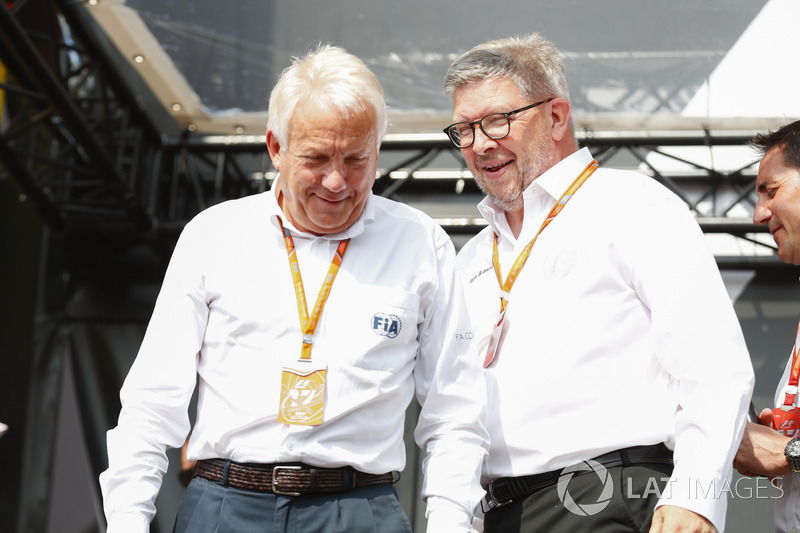 Charlie Whiting, FIA Race Director, Ross Brawn, Managing Director of Motorsports, FOM, on stage