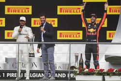 Podium: Mark Webber, Channel 4 F1, interviews race winner Lewis Hamilton, Mercedes AMG F1, third place Daniel Ricciardo, Red Bull Racing, celebrates in the background