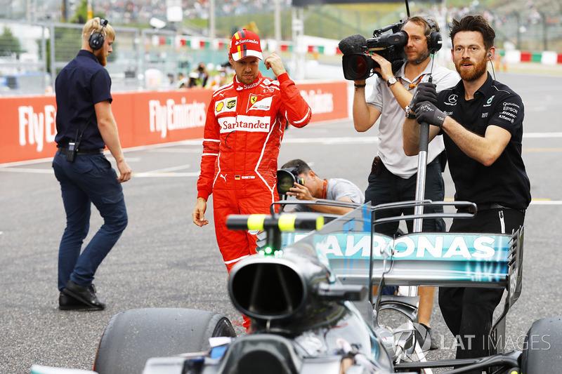 Sebastian Vettel, Ferrari, looks at the Mercedes AMG F1 W08 of Lewis Hamilton, Mercedes AMG F1