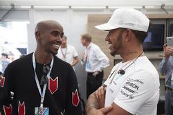 Olympic champion Sir Mo Farah talks to Lewis Hamilton, Mercedes AMG F1