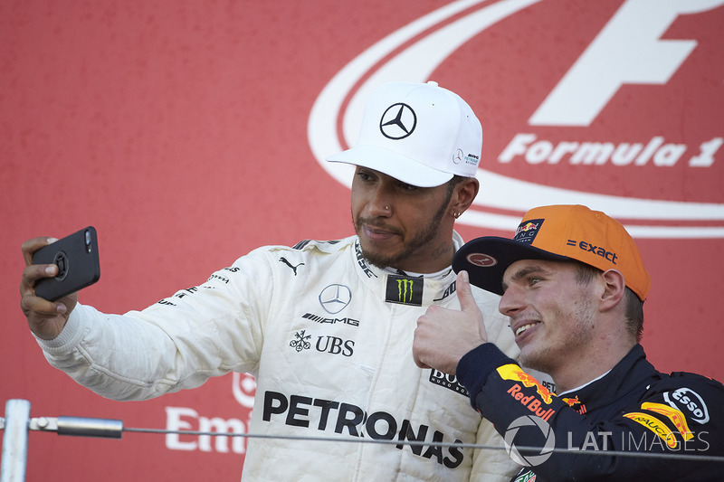 Race winner Lewis Hamilton, Mercedes AMG F1, takes a photo with Max Verstappen, Red Bull, second pla